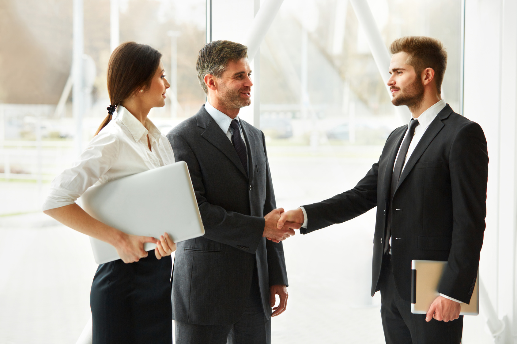 Commercial real estate agent and tenant shake hands.